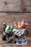 Fishing baits wobblers protrude from white metal cup Royalty Free Stock Image