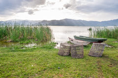 Fishing baskets and boats over Lake Jipe, Kenya Royalty Free Stock Photography
