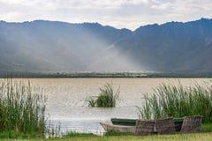Fishing baskets and boats over Lake Jipe, Kenya Stock Image