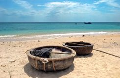 Fishing baskets on a sandy beach in Vietnam. stock photos
