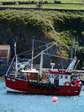 Fishing bat leaving port in Cornwall. Fishing boat leaving port from Charlestown harbor in Cornwall stock photos