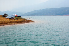 Fishing in bay Stock Photography