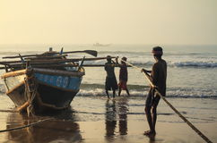 Fishing In Bay Of Bengal. Group of Indian fishers pulling the fishing net on the beach of Puri, Odisha, India Stock Photography