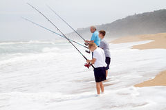 Fishing on beach stock photo