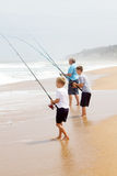 Fishing on beach Stock Photos