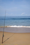 Fishing at the beach Royalty Free Stock Image