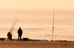 Fishing on the beach Royalty Free Stock Image