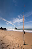 Fishing at the beach. Lonely fishing poles at the beach Stock Image