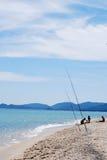 Fishing on the beach Royalty Free Stock Photos