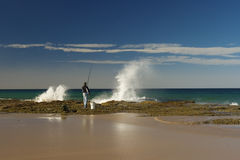 Fishing from the beach. Fisherman is fishing from the beach Royalty Free Stock Photos