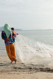 Fishing on the Beach Chinese Style Royalty Free Stock Photo