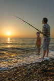 Fishing on Beach Royalty Free Stock Image