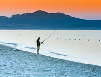 Fishing on the beach at sunrise Royalty Free Stock Photography