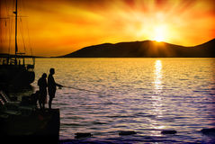 Fishing at beautiful sunset Royalty Free Stock Photography