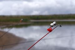 Fishing bell at the end of a fishing rod. Bells will ring when the fish is hooked.  royalty free stock images