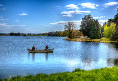 Fishing Blagdon Lake Somerset in Chew Valley at the edge of the Mendip Hills south of Bristol like painting in HDR Royalty Free Stock Photo