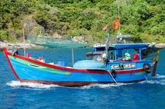 Fishing boa. Summer. Vietnamese little fishing boat Royalty Free Stock Image