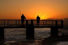 Fishing on the boardwalk Stock Image