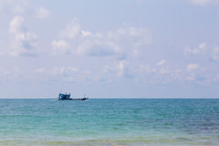 Fishing boast on the ocean skyline. Natural landscape background Royalty Free Stock Photo