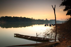 """Fishing boat . Fishing boat on the """"Moon River"""" in Thailand after sunset Stock Photo"""