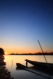 """Fishing boat . Fishing boat on the """"Moon River"""" in Thailand after sunset Stock Photos"""