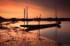 """Fishing boat . Fishing boat on the """"Moon River"""" in Thailand after sunset Royalty Free Stock Photo"""