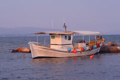 Fishing boat. At sunset Royalty Free Stock Photography
