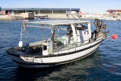 Fishing boat. Small fishing boat towed at the port Stock Photo
