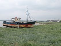 Fishing boat. Abandoned fishing boat resting on the coast of France Royalty Free Stock Images