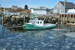 Fishing Boat. Docked in an ice filled harbor at Biddeford Pool, Maine stock photo