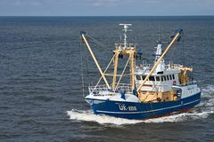 Fishing boat. A fishing boat on a calm sea Royalty Free Stock Photo