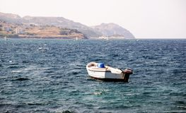 Fishing boat. Empty fishing boat floating out to sea Stock Photo