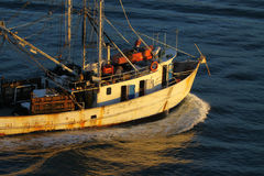 Fishing Boat. Old Rusty Fishing Boat Heading Out to Sea Royalty Free Stock Images