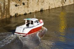 Fishing Boat. Small boat heads out to sea for a days fishing royalty free stock photos