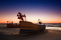 Fishing boat. On Baltic Beach in evening scenery royalty free stock photo