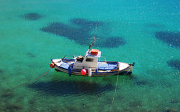 Fishing Boat. A small fishing boat moored off an island Stock Image