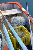 Fishing boat. A colorful old rowboat with piles of fishing net and gear Royalty Free Stock Photos