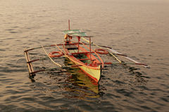 Fishing-boat. Small colorful fishing boat docked on shore Royalty Free Stock Images