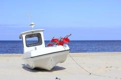 Fishing boat. Modern fishing boat on the beach on the island of Usedom, Baltic Sea, Mecklenburg-Western Pomerania, Germany Stock Photos