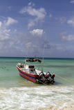 Fishing Boat. A boat ready to go out to sea by the beach Royalty Free Stock Image