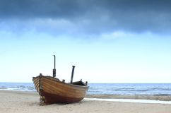 Fishing boat. On the beach of the island of Usedom in bad weather Royalty Free Stock Image