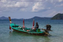 A fishing boat. Traditional thai fishing boat near Phuket island, Thailand Royalty Free Stock Photo