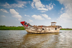 Fishing boat. National Vietnamese boat on the Mekong River Stock Photos