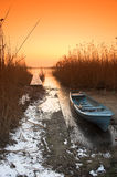 Fishing boat. In the freezing lake Stock Image