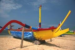 Fishing boat. Colorful fishing boat on Balinese beach stock photo