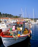 Fishing Boat. Greek fishing boat in the port of Fiscardo on the island of Kefalonia stock images