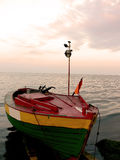 Fishing boat. On the bank of the Baltic sea, after work Stock Image