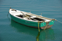 Fishing boat. An old fishing boat tied in a dock, Nafplio Greece Stock Photography