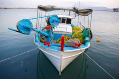 Fishing boat. Old fishing boat at the port of Kimi, Greece royalty free stock image