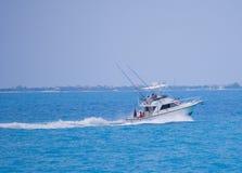 Fishing boat. Deep sea sport fishing boat cruising along the waters in Cancun stock photography
